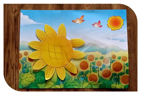 这个也是幼儿园的手工,比较简单的粘贴.由向日葵画片粘贴而成-宝