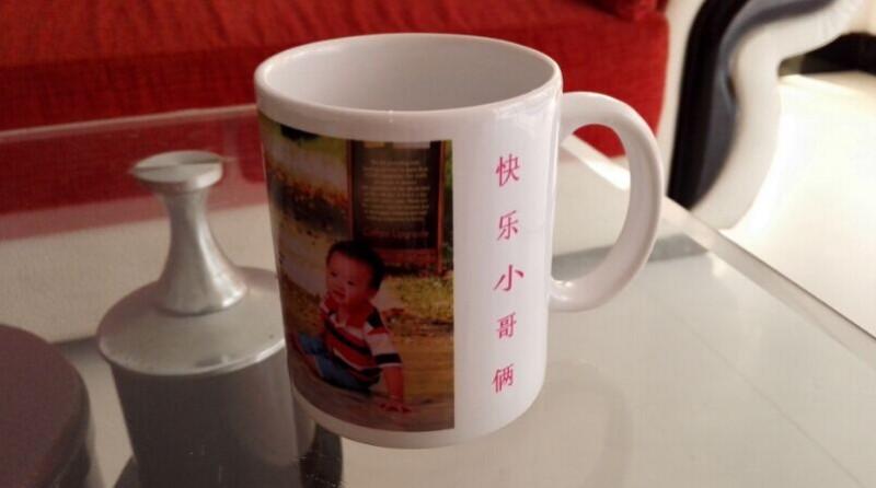 劲儿地问我这张照片是怎么印在杯子上的.然后哥俩就开始讨论这个杯